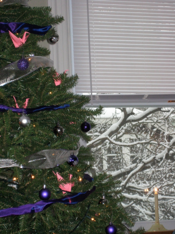 Yes. That is an Advent Tree dressed in pink handmade peace cranes and purple ribbon.