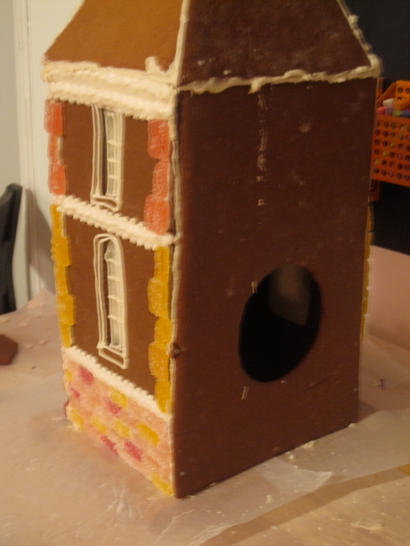 Back of the house with hole cut out for a candle